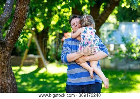 Happy Young Father Having Fun Cute Toddler Daughter, Family Portrait Together. Man With Beautiful Ba