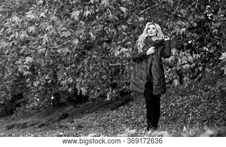 Girl Fashionable Blonde Walk In Autumn Park. Woman Wear Warm Jacket. Jackets Everyone Should Have. B