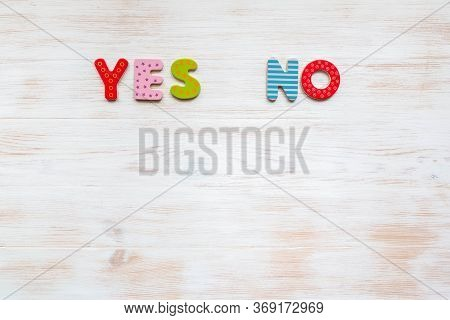 Words Yes And No Of Colorful Letters On Vintage Wood Background. Colored Words Yes And No On Wood Ba