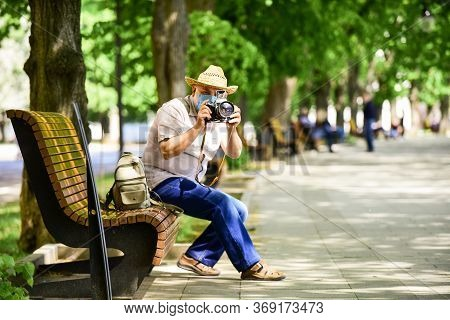 Tourist Use Camera Take Photo. Urban Photography. Senior Man In Respirator Mask. Professional Photog