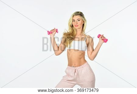 Woman With Perfect Abs Do Exercise. Fit Blond In Great Shape. Female Fitness Girl Lifting Dumbbell.