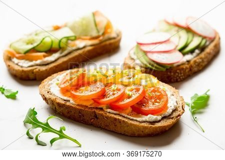 Variety Of Sandwiches For Breakfast, Snack, Appetizers - Avocado, Radish, Tomatoes, Bacon, Cucumbers