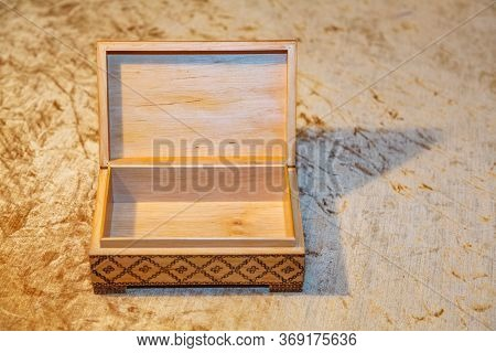 A Small Wooden Casket For Storing Valuables