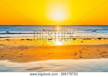 Sunset On Beautiful Sand Beach