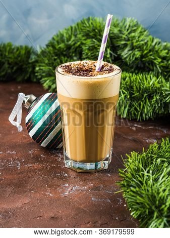 Frappe Milk Shake Coffee In Tall Glass On Blue And Brown Background. Christmas New Year Holiday Drin