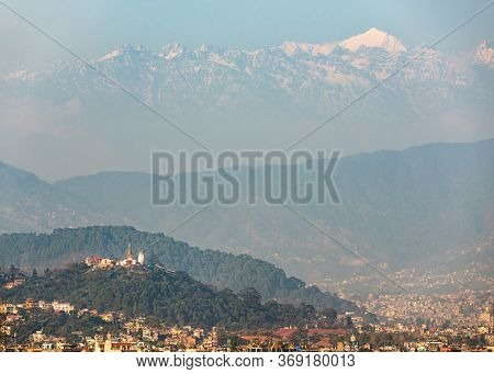 Swayambhunath stupa also called Monkey Temple in Kathmandu, Nepal. In the background the Langtang range, a subrange of the Himalayas.