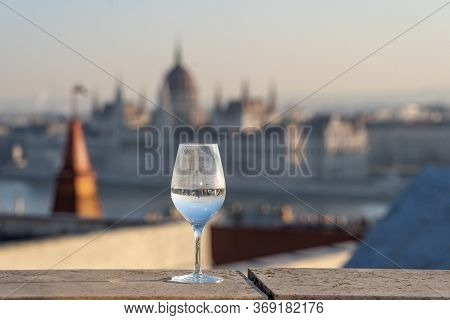 Reflection In Wine Glass Of Hungary Paliament Hazy Figure In The Background
