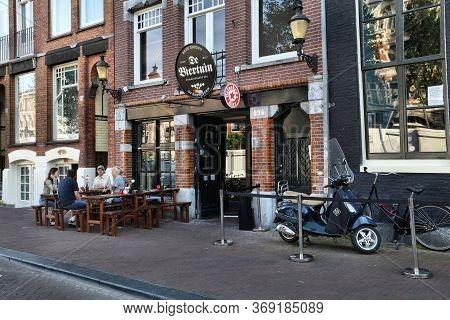Amsterdam, Netherlands - July 9, 2017: People Visit De Biertuin Beer Garden Restaurant In Amsterdam'
