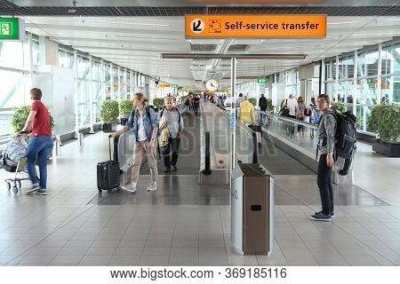 Amsterdam, Netherlands - July 7, 2017: Travelers Visit Schiphol Airport In Amsterdam. Schiphol Is Th