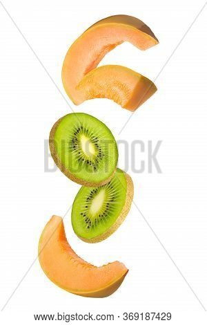 Flowing Melon And Kiwi Fruits Isolated On White Background With Shallow Depth Of Field