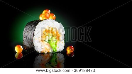 Sushi roll japanese food over black background. Sushi roll with tuna, vegetables, flying fish roe and caviar closeup. Japan restaurant menu. Wide screen
