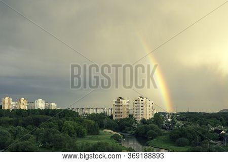 Rainbow Over Tall Buildings. Rainbow On The Background Of A Modern City. Rainbow Over The City