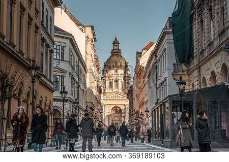 Budapest, Hungary - Feb 8, 2020: Hustling Street View Of St. Stephens Basilica Before Sunset