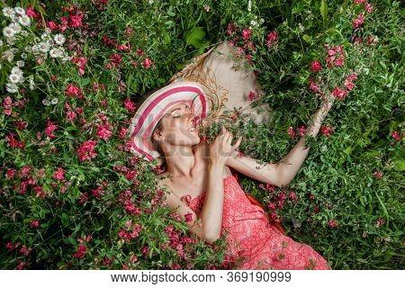 Woman lies in wild flowers