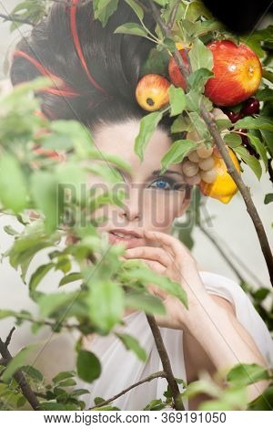Fantasy portrait of a woman with fruits