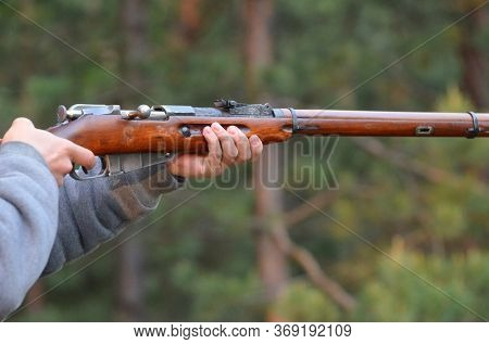 Unformal shooting range near Kiev. Vintage Soviet Mosin rifle of WWI and WWII .June 1,2020. Kiev Region, Ukraine