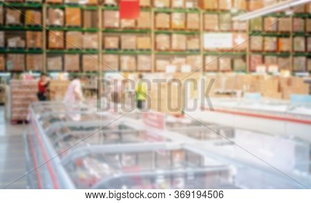 Abstract Blur Effect At The Warehouse Store Food With The Refrigerator And Freeze Foods, Cartons Of