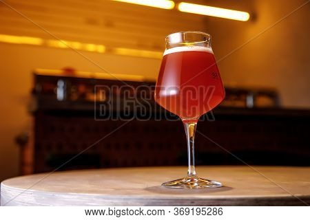 Beer Glass In Bar Interior. Craft In Pub.