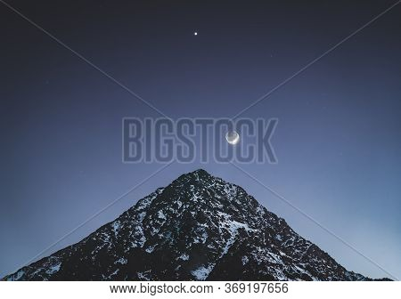 Night Fall Scene With Moon And Stars Above Imlil Village. Small Village In High Atlas Mountains In M