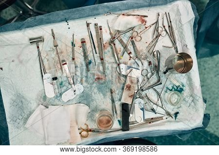 Surgical Instruments And Instruments, Including Scalpels, Forceps And Tweezers, Located On The Table