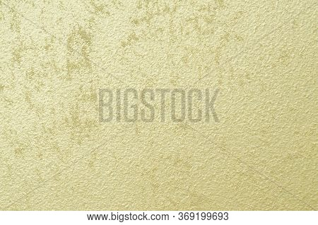 Golden, Yellow Putty. Texture. Abstract Heterogeneous Background. Decorative Finishing Building Mate