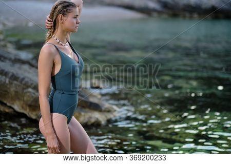 Bikini girl on the beach. Young beautiful woman in bikini on the beach on Adriatic Sea