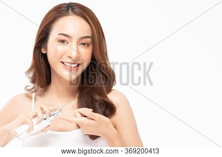 Beauty Asian Woman  Brown Hair Looking Smile In Camera Happiness And Hold Bottle Cosmetic Cream Loti