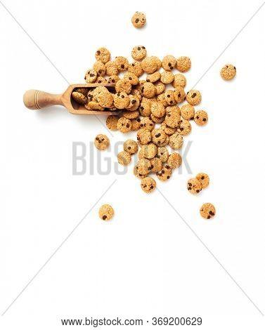 Chocolate chip cookies cereal in wooden scoop