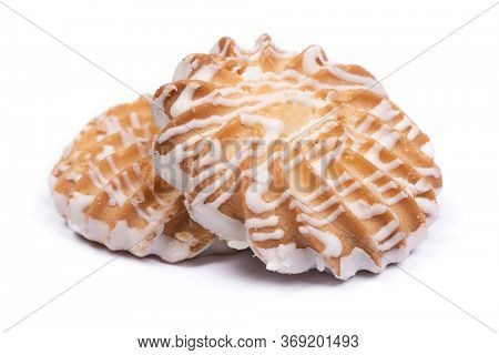 Group of cookies drizzled with white chocolate isolated on white background