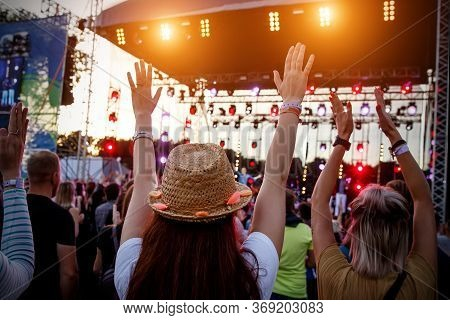 People With Raised Hands At Summer Music Festival.
