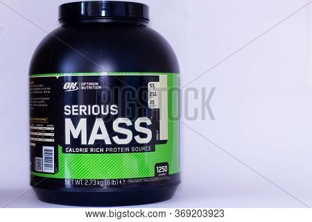 London, England - 05/31/2020: A Large Tub Of Bodybuilding Serious Mass Bulking Powder And A Smaller