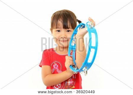 Girl playing musical instrument