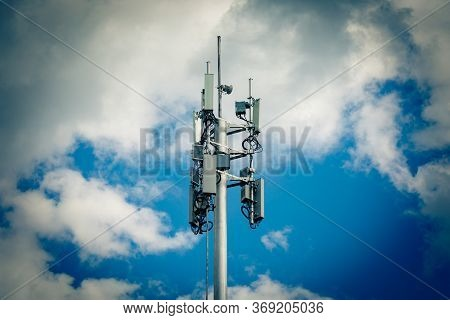 Telecommunication Tower With 4g, 5g Transmitters. Cellular Base Station With Transmitter Antennas On