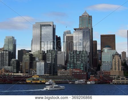 May 18, 2019 - Seattle, Wa:  Water View Of Boat Racing Along The Water In Front Of Downtown Seattle