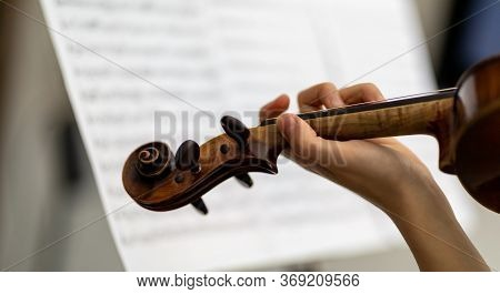 Woman Violinist Playing An Antique Baroque Violin