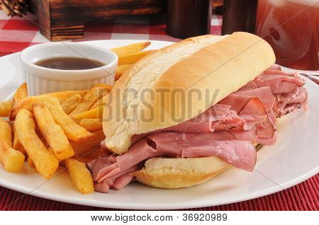 Roast beef au jus with french fries poster