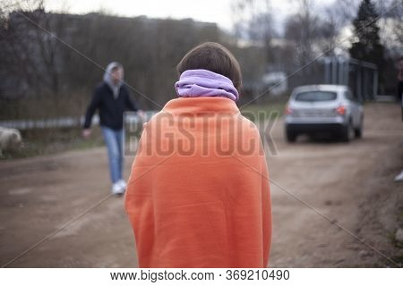 A Blanket On The Shoulders Of A Girl. The Woman Froze And Covered Herself With A Warm Blanket. The G