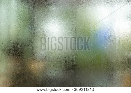 Window With Condensate Or Steam After Heavy Rain, Large Texture Or Background. Misted Glass, Silver