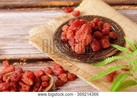 Dried Fruits, Strawberry In Dark Wooden Plate On Vintage Wooden Backgrounds. Selective Focus.