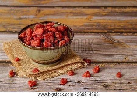 Dried Fruits, Strawberry In A Bowl On Vintage Wooden Backgrounds. Selective Focus.