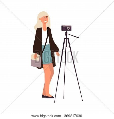 Young Cute Caucasian Woman Or Girl Photographer Makes A Photo With A Camera On A Tripod.