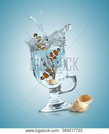 Clown fish in a wine glass. Concept of escape