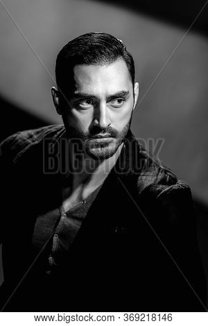 Bw Portrait Of Fashionable Young Man With Beard On Dark Background