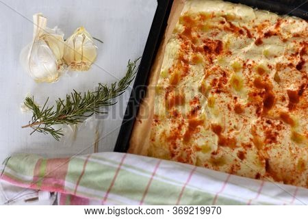 Homemade Italian Focaccia Modenese, With Rosemary And Olive Oil Freshly Baked And Ready To Eat. Arom