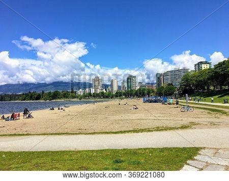 Vancouver, British Columbia, Canada - May 18th, 2020: The Somewhat Crowded Beaches Of English Bay, W