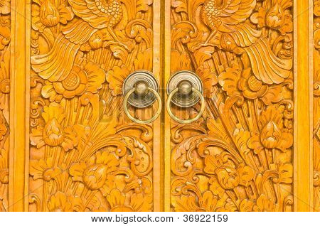 Wooden Door Of Country House With Carved Ornament