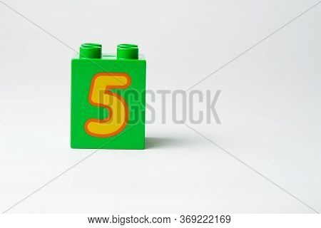 The Number Five Written On The Block From The Childrens Constructor