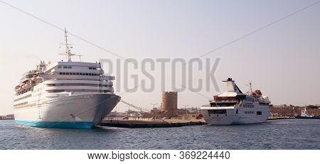 Rhodes, Greece - June 06, 2019: Celestyal Olympia Cruise Ship In The Port Of Rhodes, Mandraki Harbou