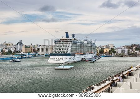San Juan, Puerto Rico - April 29, 2019: Passengers On The Deck Of A Cruise Ship Enjoying The View Of