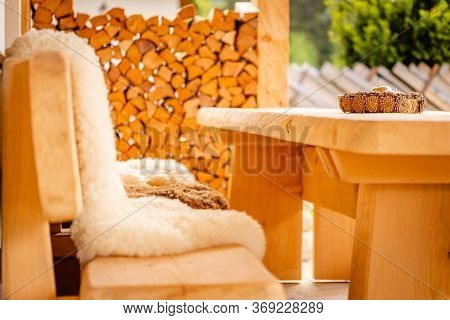 New Stylish Wooden Table Outside Of A Modern Lodge Inviting To Relax And Enjoy